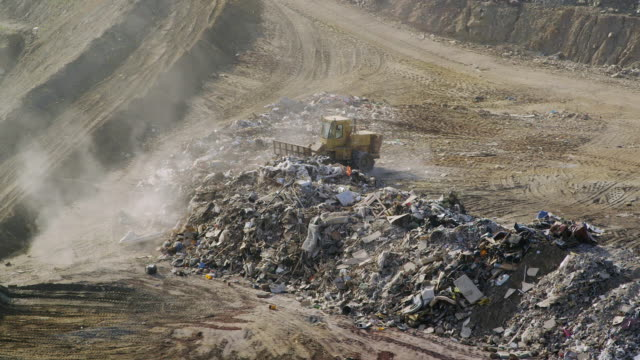 ms compactor working on landfill site / marbella, andalusia, spain   - landfill stock videos & royalty-free footage