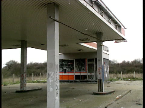 company failures/ bankruptcies nat cms derelict forecourt roof of filling station closed because of recession pull out ms building at filling station... - recession stock videos & royalty-free footage