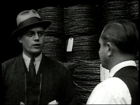 company owner james b. harris checking spools of barbed wire worker suggests they could sell to war harris saying they don't need to. memo 'this... - anno 1935 video stock e b–roll