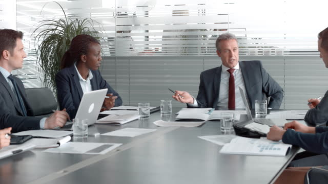 company's ceo holding a corporate meeting with business partners in the conference room - board room stock videos & royalty-free footage
