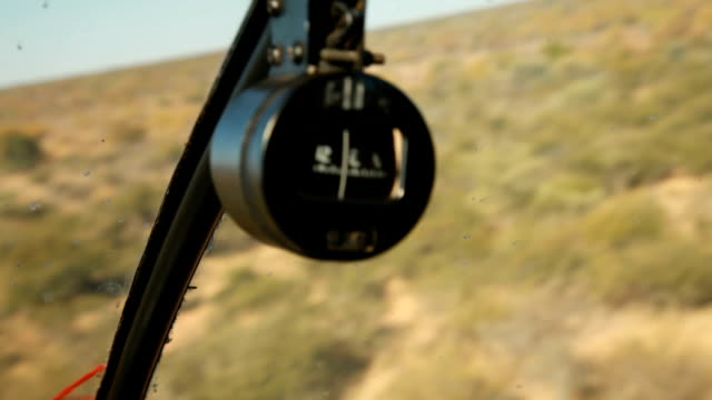 Compass of helicopter flying over the bushveld Rhino poaching is a major threat to the extinction of rhinos living in and around nature reserves in...