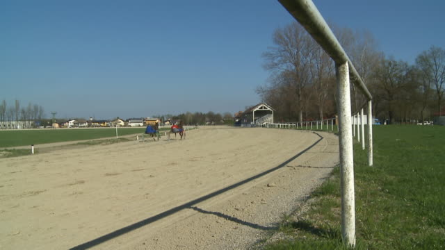 hd slow-motion: competition between two horses - horseracing track stock videos and b-roll footage