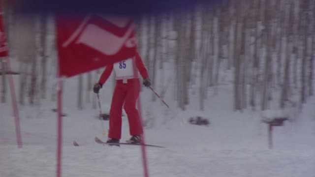 A competitive skier navigates a slalom course in Colorado.