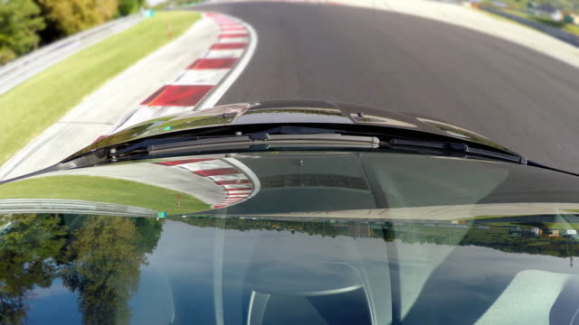 Competitive sports car driving, view of windshield