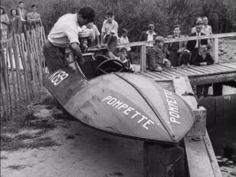 competitor fixes an engine to his speed boat, prior to a race on oulton broad in suffolk. - jet boating stock videos & royalty-free footage