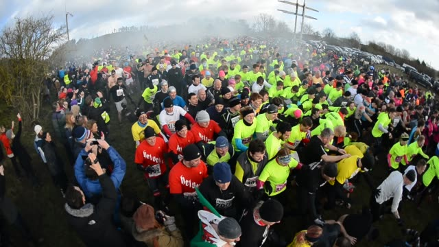 competitors at the start of the tough guy challenge endurance race on january 27 2013 in telford england every year thousands of people run the 8... - endurance race stock videos and b-roll footage