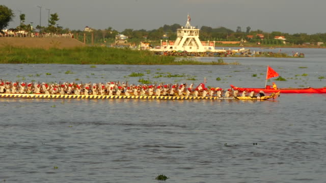 competitors cross the finishing line in a close race on the first day of racing during the annual water festival on november 13 2016 in phnom penh... - bロール点の映像素材/bロール
