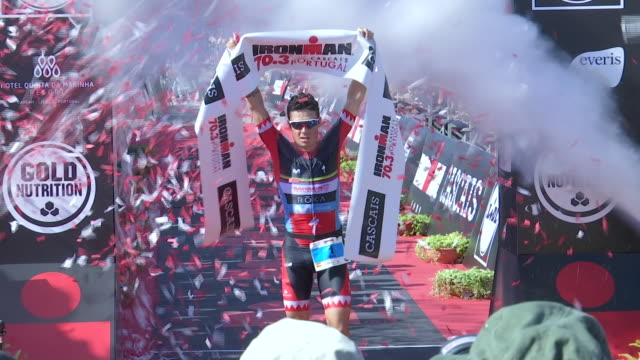 competitors of ironman 70.3 in cascais, portugal. some 3000 competitor from 75 countries participated in ironman 70.3 cascais, won by in pro men... - triathlon stock videos & royalty-free footage