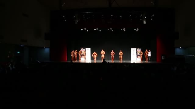 competitors pose on stage during the 2014 ifbb victorian bodybuilding championship on october 05 2014 in melbourne australia - spray tanning stock videos & royalty-free footage