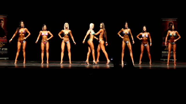 Competitors pose on stage during the Victorian Bodybuilding Championship on October 8 2017 in Melbourne Australia