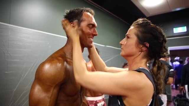 competitors prepare backstage during the 2014 ifbb victorian bodybuilding championship on october 05 2014 in melbourne australia - spray tanning stock videos & royalty-free footage