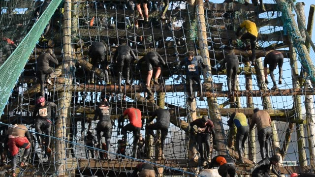 competitors scale the 160ft 'tiger' obstacle during the tough guy challenge endurance race on january 27 2013 in telford england every year thousands... - endurance race stock videos and b-roll footage