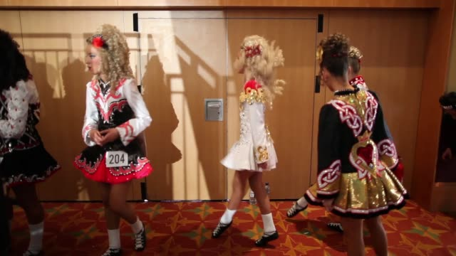 competitors wait backstage before performing at the world irish dance championship on april 13 2014 in london england the 44th world irish dance... - championships stock videos & royalty-free footage