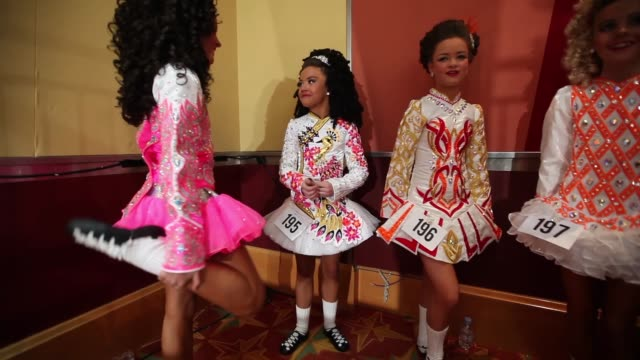 competitors wait backstage before performing at the world irish dance championship on april 13 2014 in london england the 44th world irish dance... - championships stock videos and b-roll footage