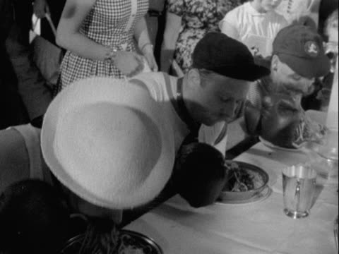 competitors wear boxing gloves for a spaghetti-eating contest which is part of the soho fair celebrations in central london. - moustache stock videos & royalty-free footage