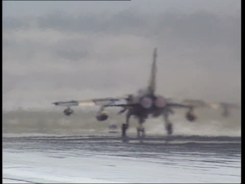 compilation 2 saudi arabia dhahran ext various shots of tornado aircraft on runway as they prepare for take off / cu of aircraft engines as... - afterburner stock videos and b-roll footage