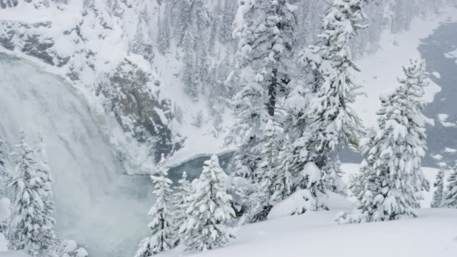 vidéos et rushes de compilation of a small waterfall by the river and the snowy upper falls - pin