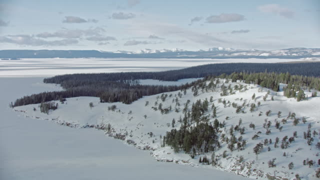 compilation of a snowy mountain range and the frozen yellowstone lake - snow stock videos & royalty-free footage