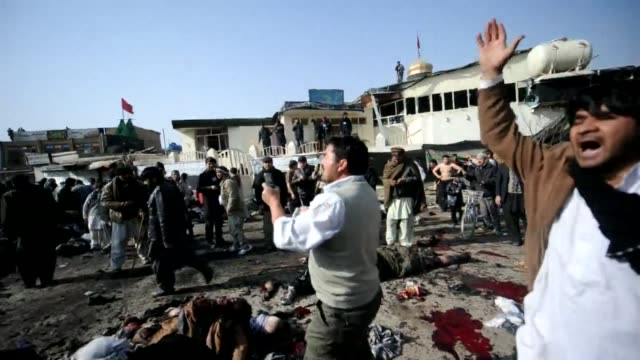 compilation of footage from a suicide attack on a kabul shrine on december 6 that killed more than 50 people, including the immediate aftermath of... - terrorismus stock-videos und b-roll-filmmaterial