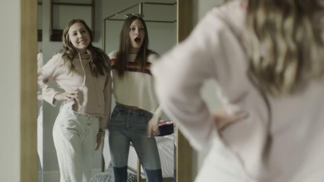 stockvideo's en b-roll-footage met compilation of smiling teenage girls trying on clothing in bedroom mirror / cedar hills, utah, united states - moving past