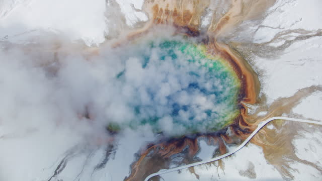 compilation of the grand prismatic spring - pull out camera movement stock videos & royalty-free footage