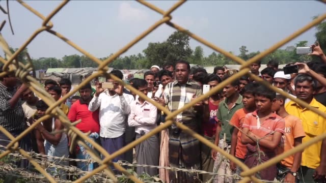 stockvideo's en b-roll-footage met compile of footage from an official media trip to northern rakhine state including shots of inn din village various construction work burned villages... - myanmar