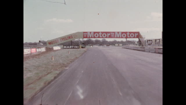 A complete lap of the Silverstone Motor Racing Circuit in Northamptonshire England filmed from a car being driven around the circuit 2nd May 1964...
