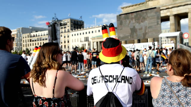 completely disappointed fan in a germany jersey and hat in the colors of the german flag on the fan mile at the brandenburg gate after the historic... - national team stock videos & royalty-free footage