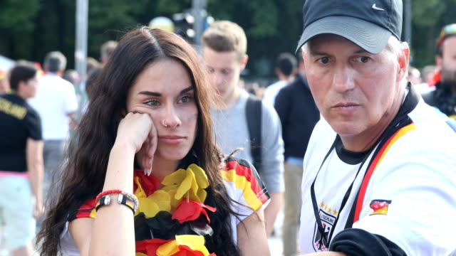 completely disappointed fans on the fan mile at the brandenburg gate after the historic defeat of the german national football team 2018 fifa world... - national team stock videos & royalty-free footage