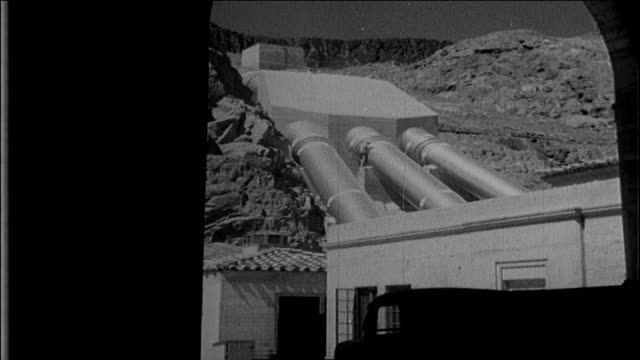 completion of the colorado river aqueduct mt san jacinto mountain range whitsett intake pumping plant caucasian adult male workers in tunnel behind... - wasserpumpanlage stock-videos und b-roll-filmmaterial