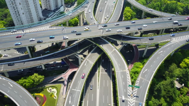 complex highway overpass in shanghai, china, aerial - commuter stock videos & royalty-free footage