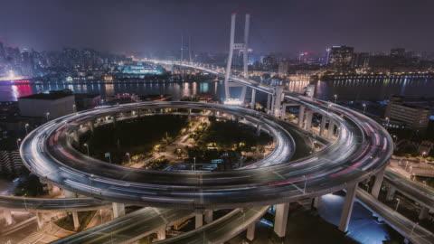 complex interchange in shanghai at night - evolution stock videos & royalty-free footage