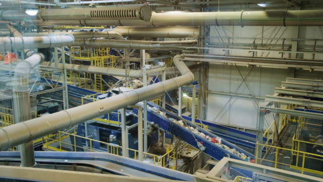complex interior of waste management processing facility - manufacturing machinery stock videos & royalty-free footage