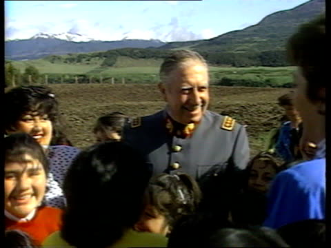 compliation rushes countryside gv's pinochet meeting locals / miners gv's visiting sick in hospital / baby unit - chile stock-videos und b-roll-filmmaterial