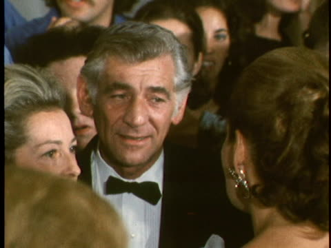 cu of composer leonard bernstein and his wife feliciacohnmontealegremingle with guests and reporters on the opening night of the john f... - john f. kennedy center for the performing arts stock videos & royalty-free footage