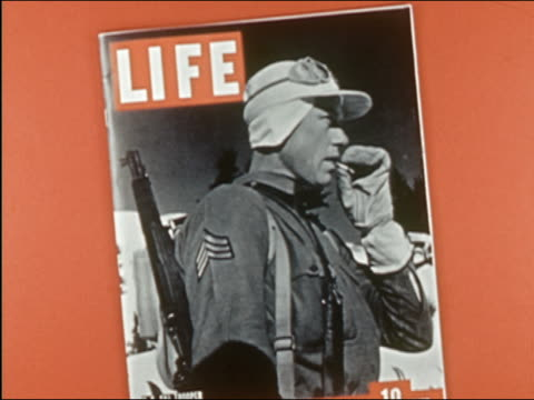 """1941 composite close up cover of ""life"" magazine /""mademoiselle"" and ""bride's"" popping up to cover ""life"""" - zeitschrift stock-videos und b-roll-filmmaterial"