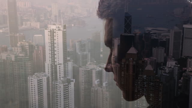 Composite image of man looking out over city