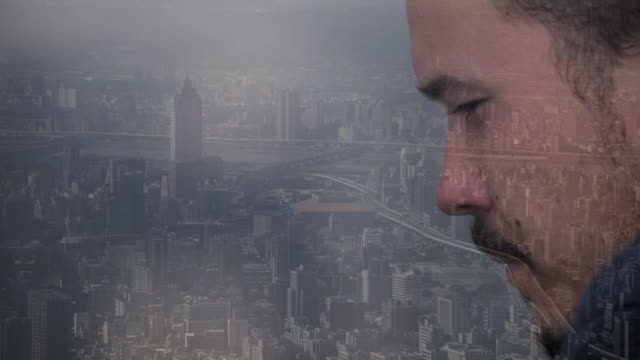 composite image of man looking out over city - facial hair stock videos & royalty-free footage