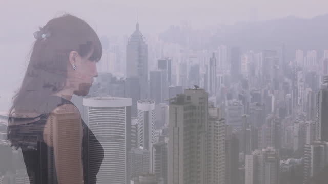 Composite image of woman looking out over city