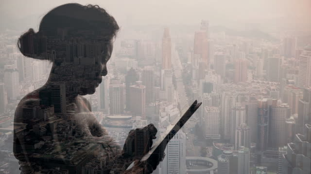 Composite image of woman with tablet device and city