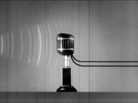1943 composite medium shot sound  waves hitting microphone and sound being transmitted through wires - microphone stock videos & royalty-free footage