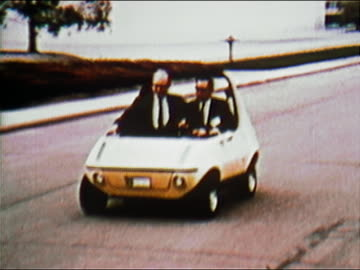 1970 composite medium shot tracking shot two men driving in white convertible fuel-efficient car / fade to silver fuel-efficient car - film composite stock videos & royalty-free footage