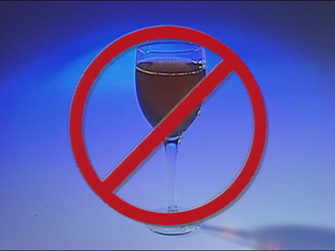 1991 composite prohibitory symbol over glass of wine / audio - alcohol drink stock videos & royalty-free footage