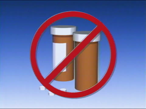 1991 composite prohibitory symbol over pill bottles and pills / audio - pill bottle stock videos & royalty-free footage