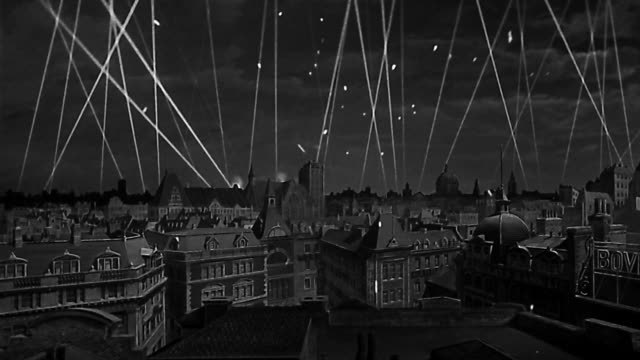 1943 reenactment composite wide shot searchlights and antiaircraft fire over model of london - bomb stock videos and b-roll footage
