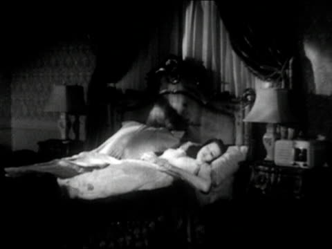 vídeos y material grabado en eventos de stock de 1944 composite wide shot spirt of sleeping woman (yvonne de carlo) getting up and walking away from bed/ audio - aparición conceptos