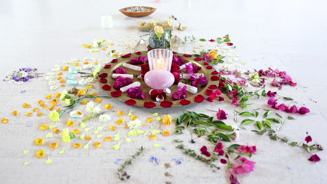 composition of flowers, stones and candle - new age stock videos & royalty-free footage