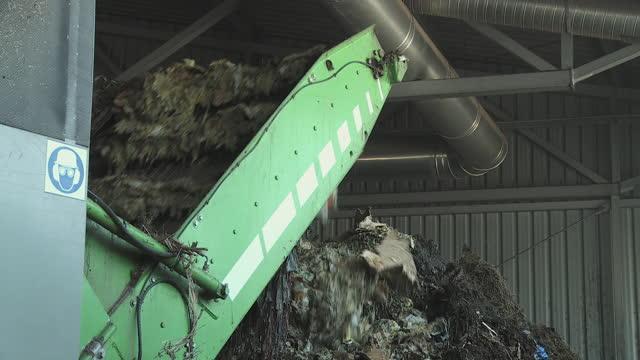 cu compost falling from composting machine, vrhnika, slovenia - vrhnika stock videos & royalty-free footage