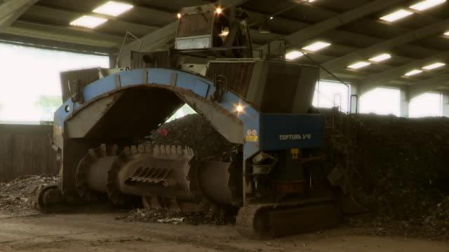 compost turner at work in a warehouse - heap stock videos & royalty-free footage
