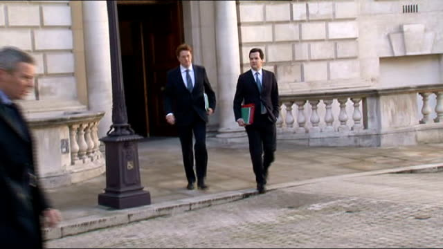 london ext george osborne mp and danny alexander mp from treasury building and towards waiting car - ジョージ・オズボーン点の映像素材/bロール